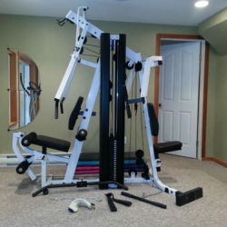 Image showing the Body-Solid StrengthTech EXM2500S fully assembled in a small room
