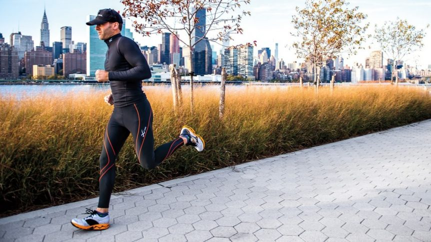 Image of a man running down the sidewalk in compression gear