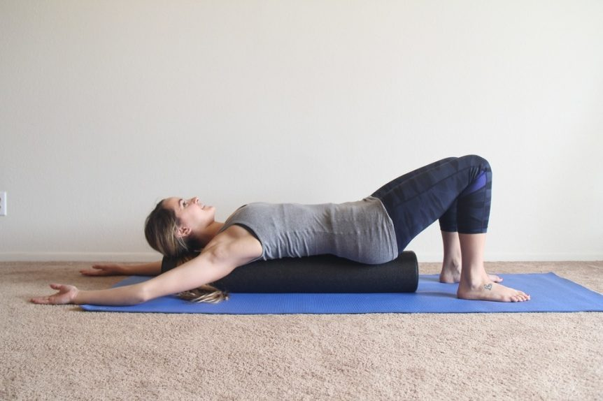 Image of a woman demonstrating a foam roller thoracic spine matrix exercise