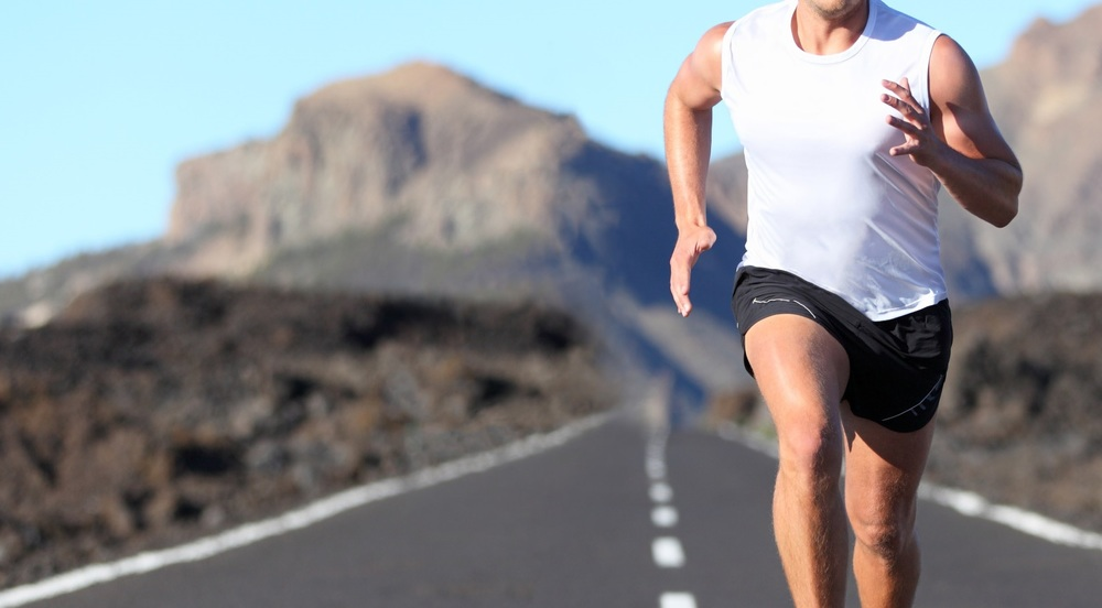 Image of a man running down a road