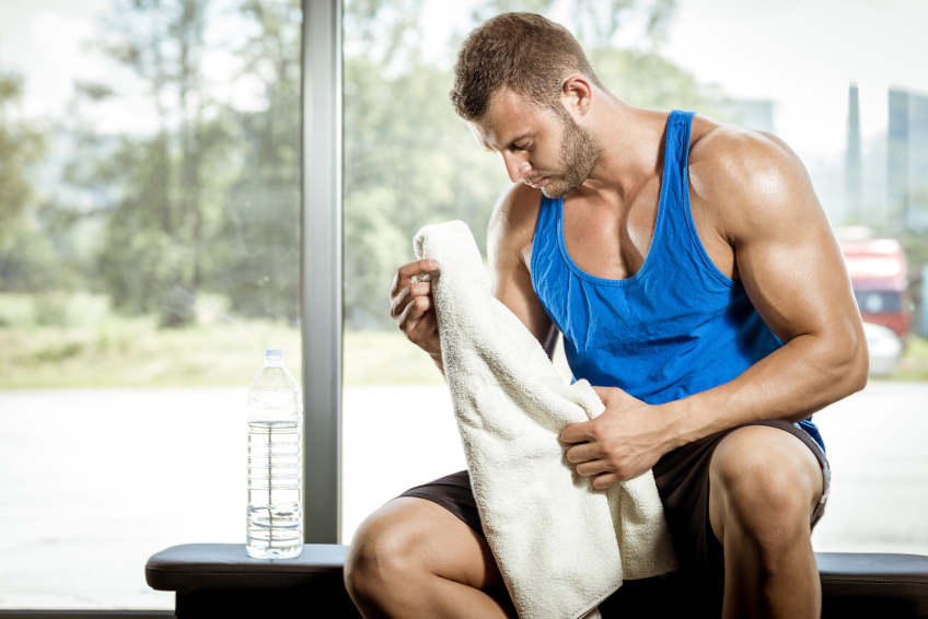 Image showing a man using a gym towel after a workout