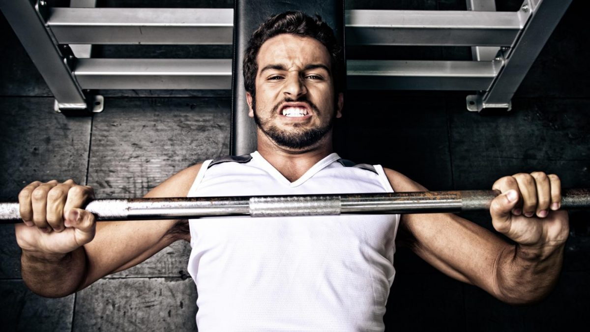 Image of a man using a bench press