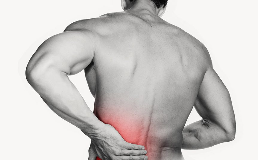 Image of a man grabbing his back due to muscle soreness and inflammation