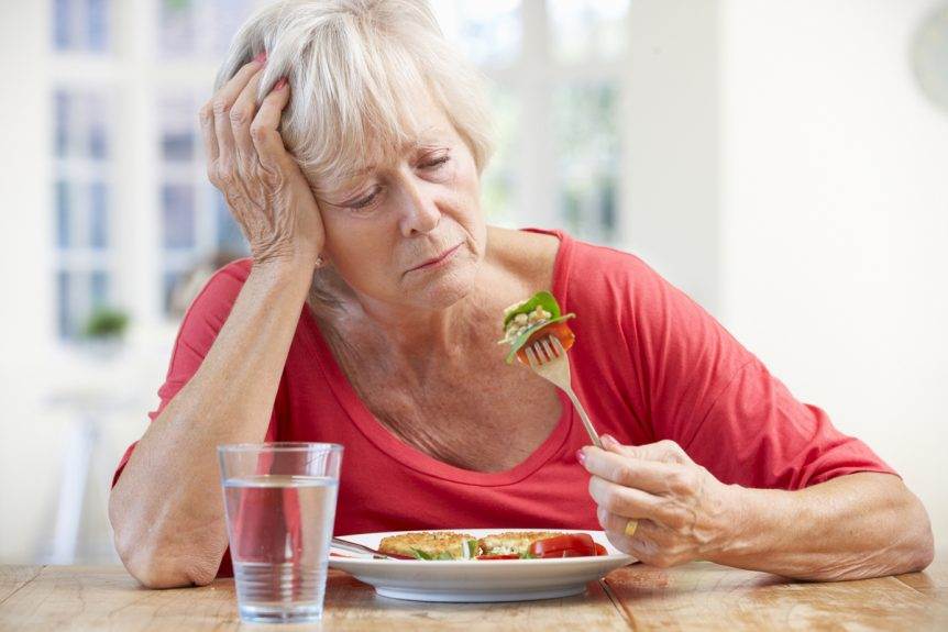 Image showing a woman staring at food with no appetite