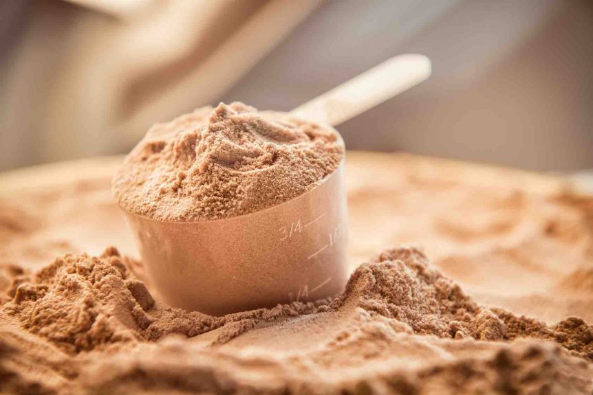 Image of a scoop of chocolate protein powder