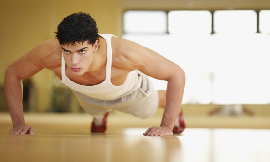 Image of a man doing a push up