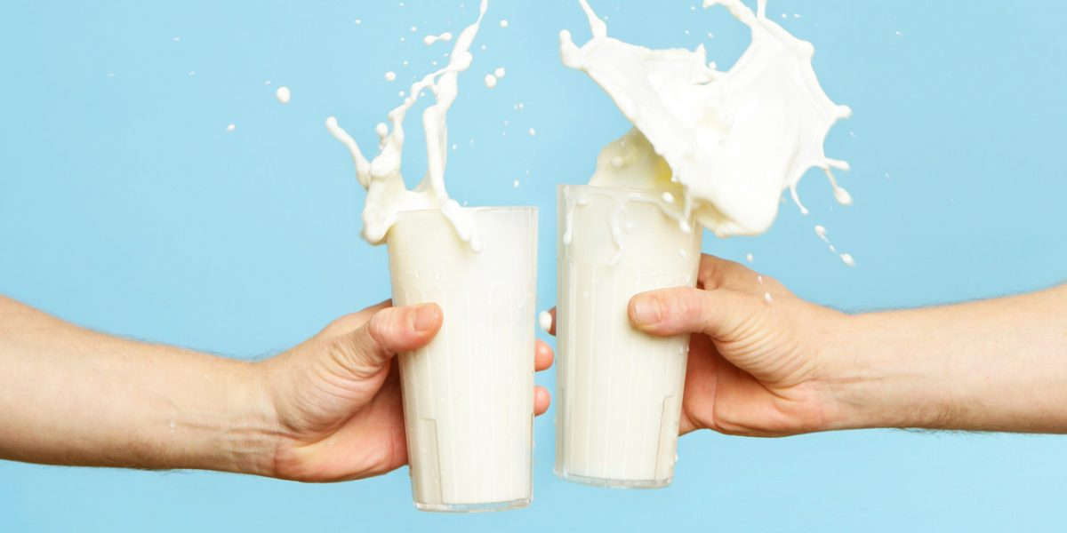 Image showing two people toasting milk glasses