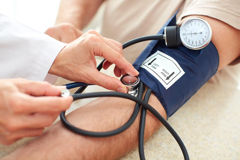 Image showing a doctor checking a man's blood pressure