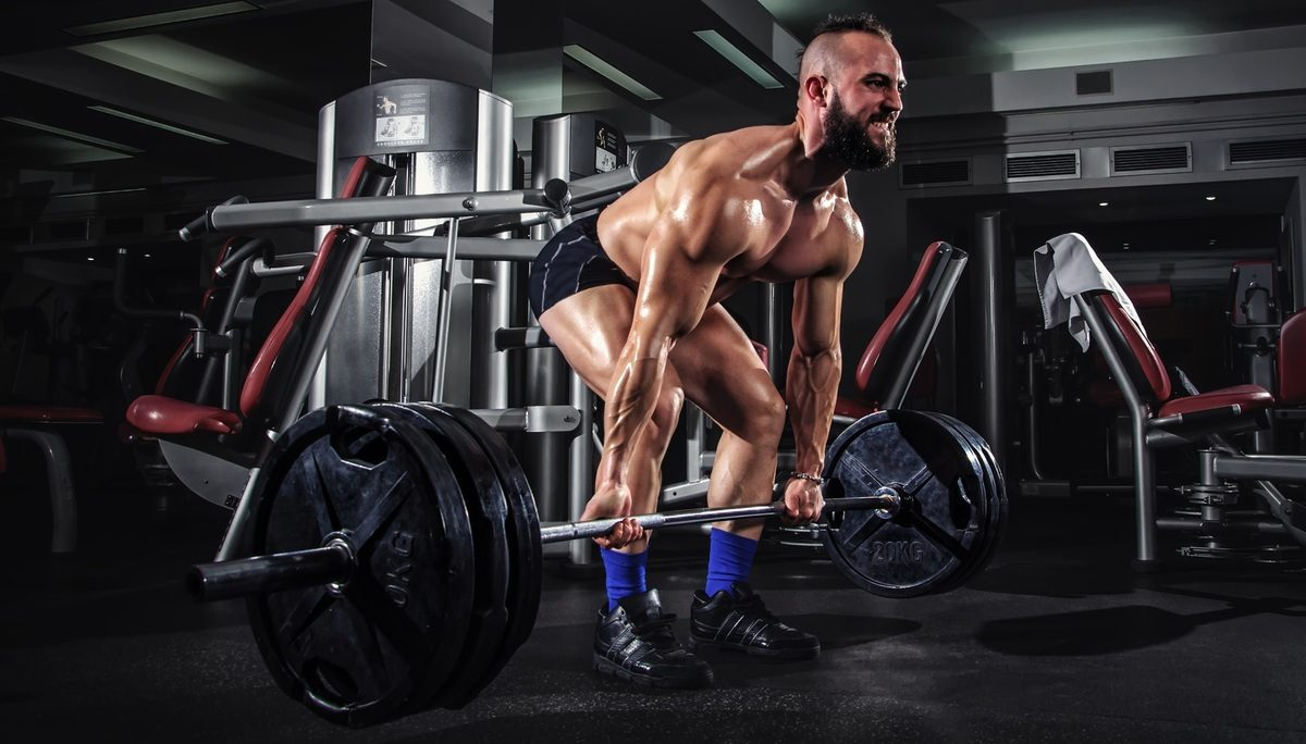 Image of a man performing the barbell deadlift