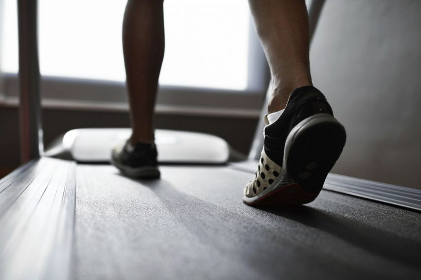 Image of a man walking on a treadmill