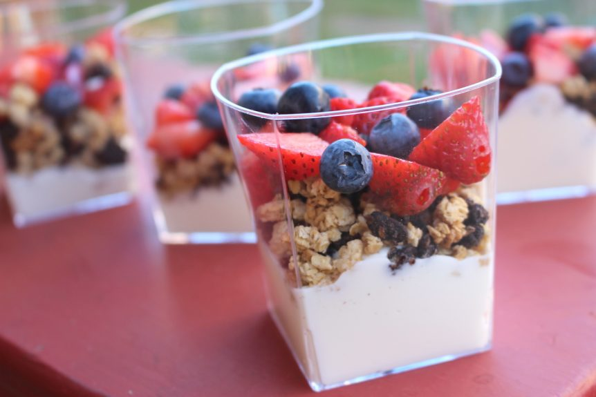 Image of a cup of greek yogurt parfait with oatmeal and fruit