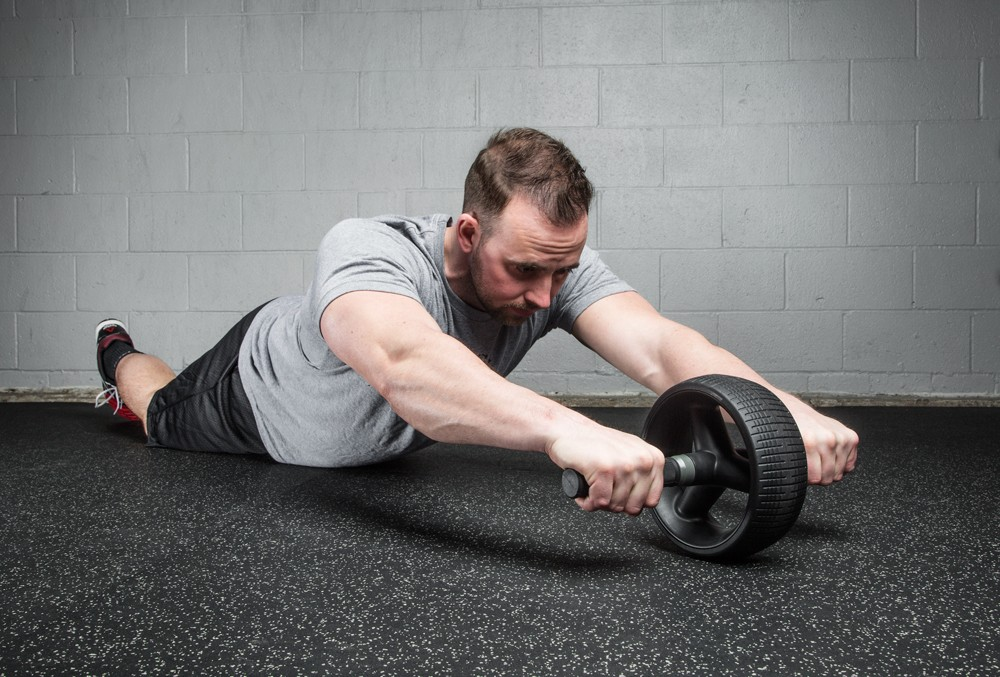 Image of a man using an ab roller