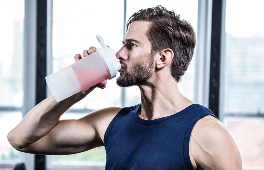 Image of a man drinking pre-workout