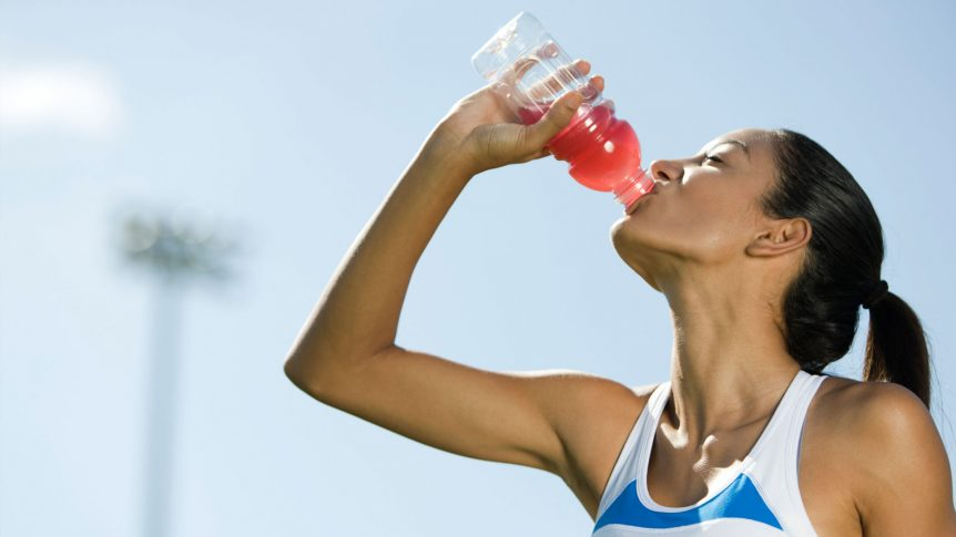 Image of a woman drinking a sports drink