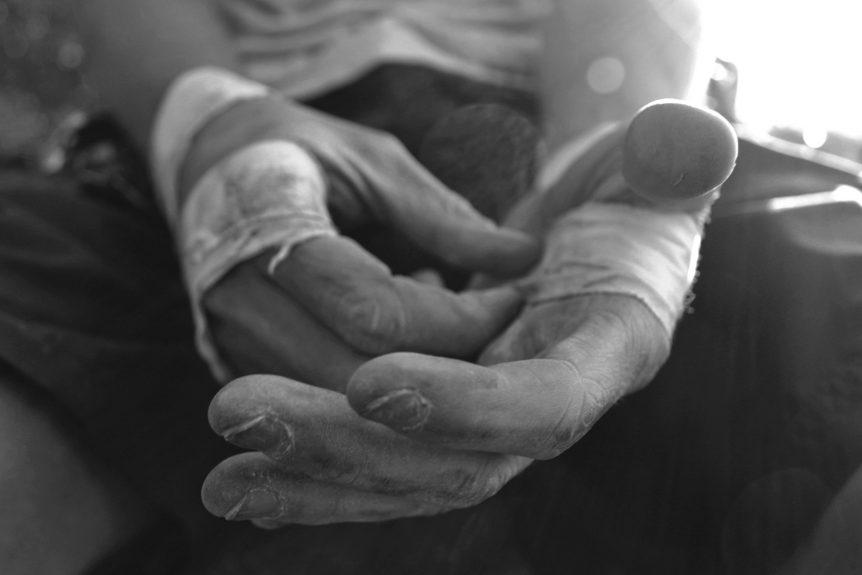 Image of a man's tough hands
