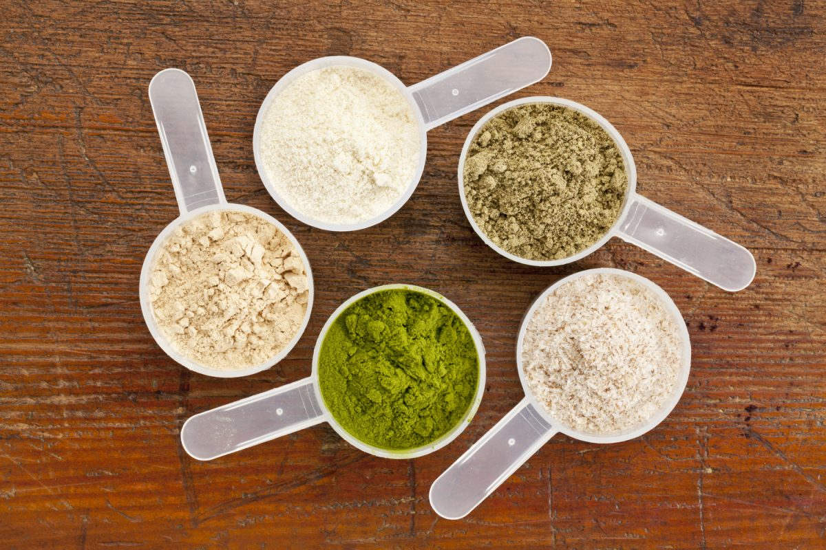 Image showing a circle of protein powder scoops filled with protein