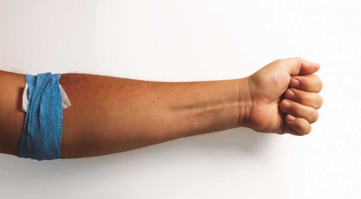 Image of a man's arm wrapped after giving blood