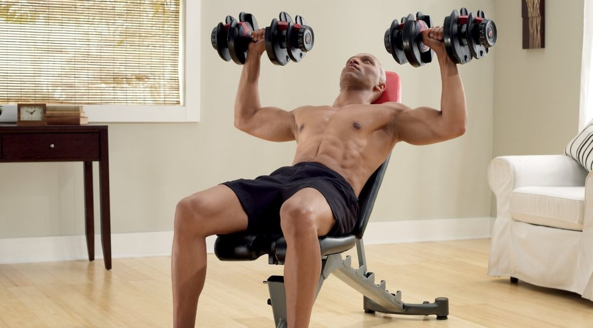 Image of a man using an adjustable weight bench