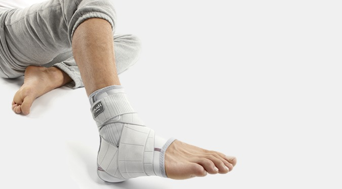 Image of a man laying down wearing an ankle brace