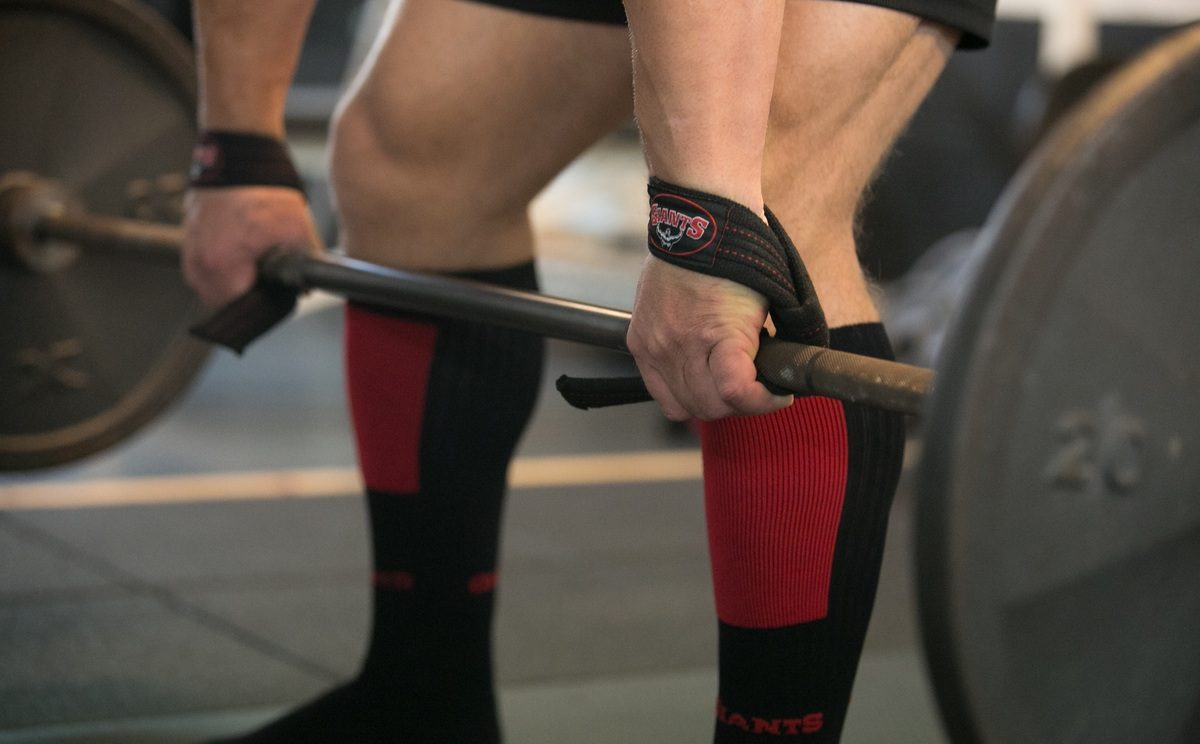 Image of a man preparing for a deadlift