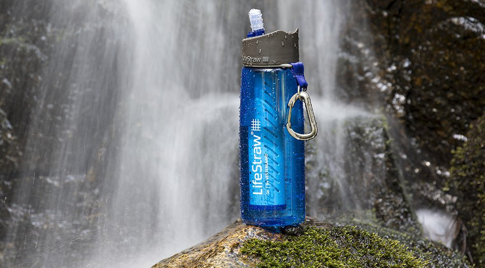 Image of a filtered water bottle sitting on a rock