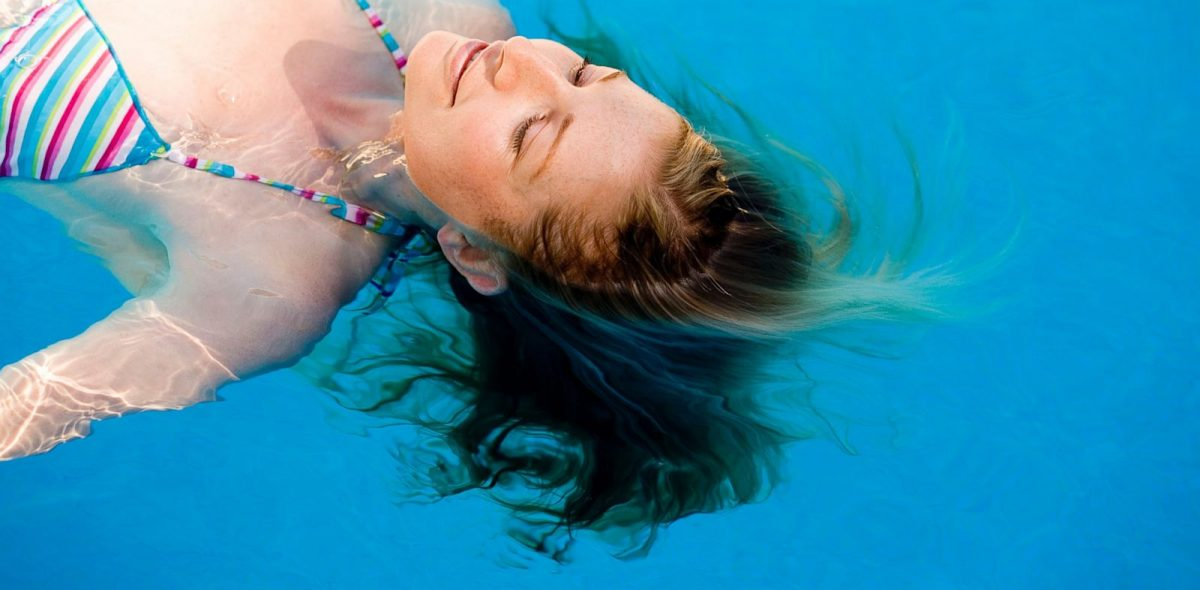 Image of a woman swimming in a pool