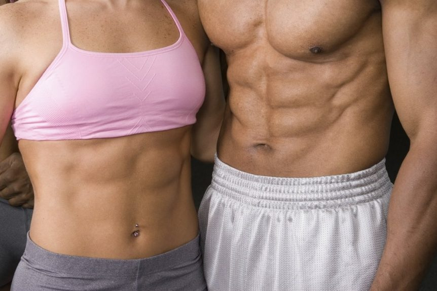Image of a man and woman with six pack abs