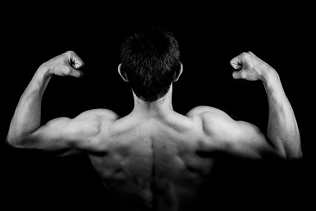 image of a guy flexing arm muscles