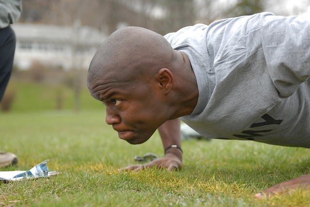 a soldier doing pushups with hands close together
