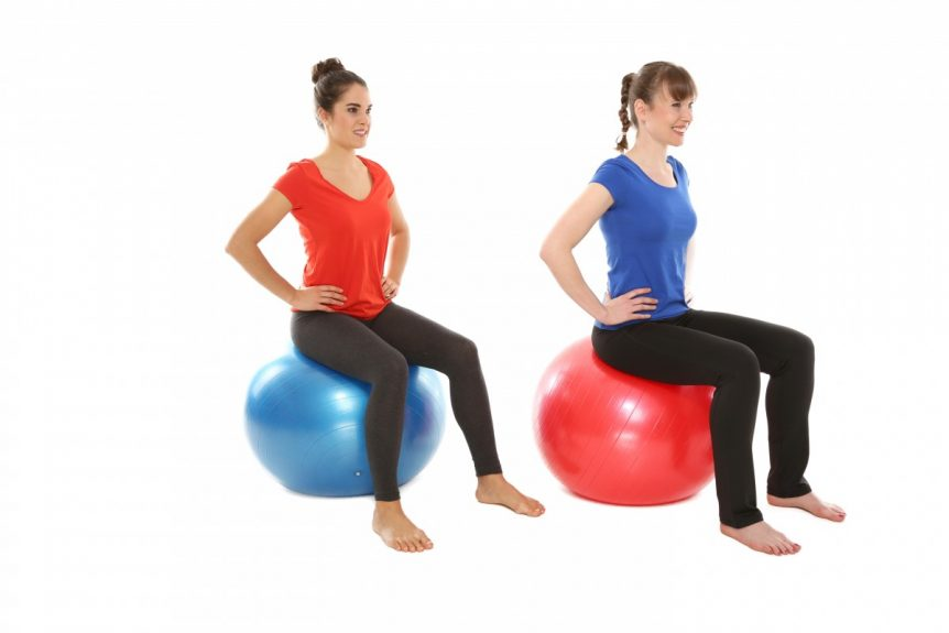 two women on swiss balls doing exercises