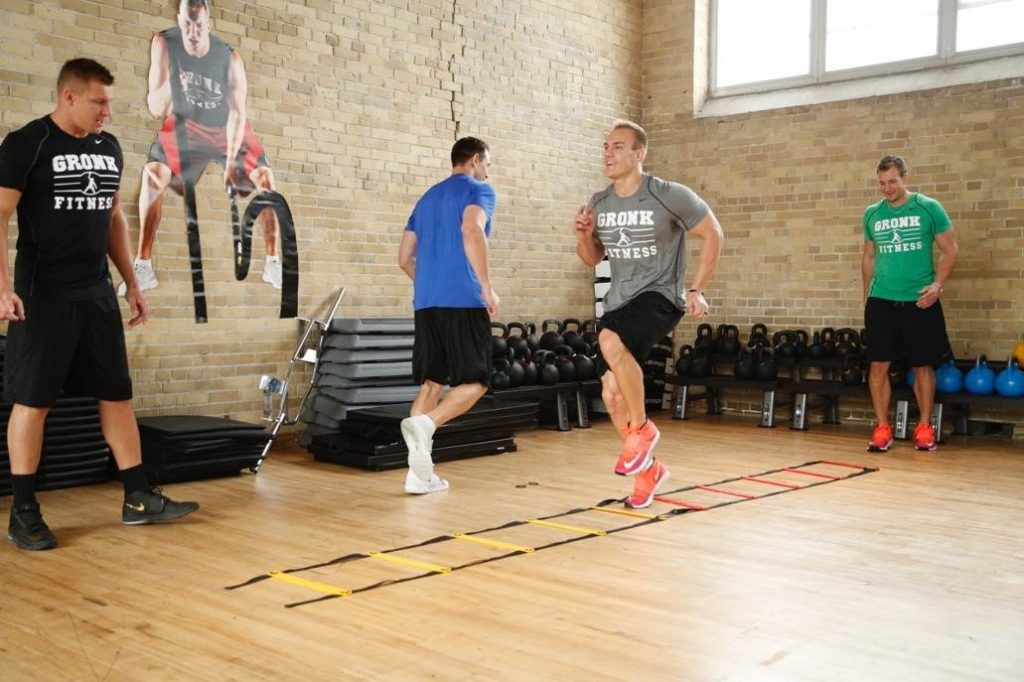 Chris Gronkowski warming up with rope ladder
