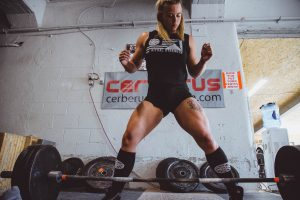 Woman in front of a barbell